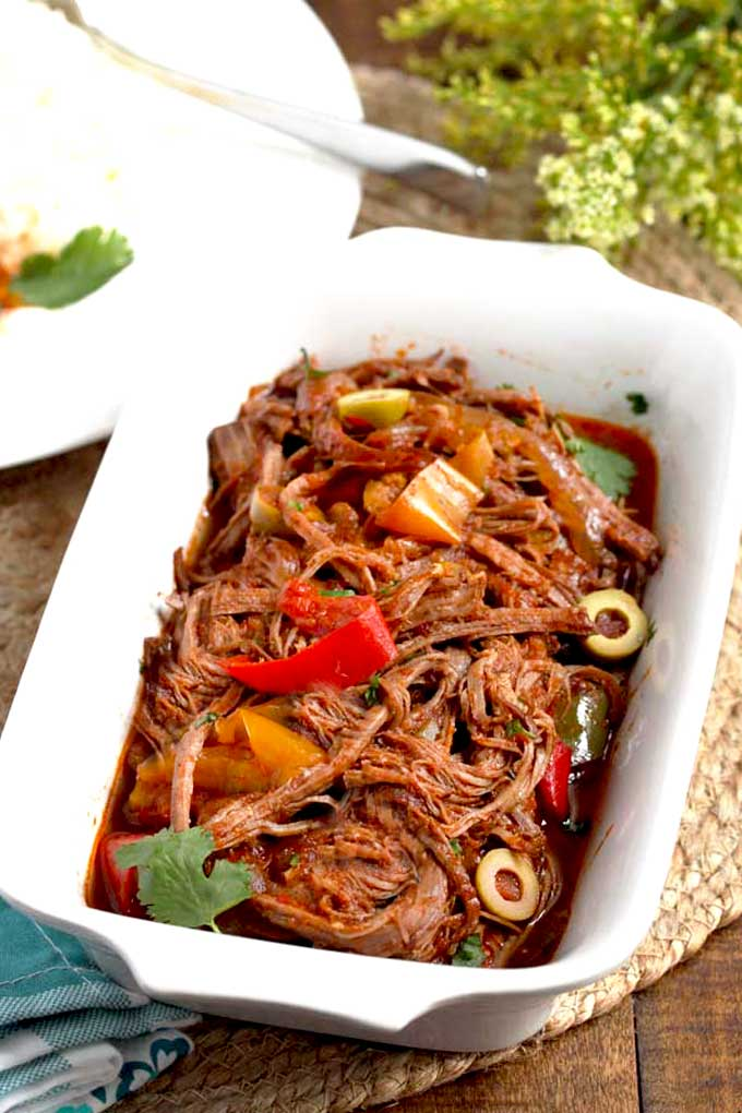 Cuban Ropa Vieja in a white serving bowl.