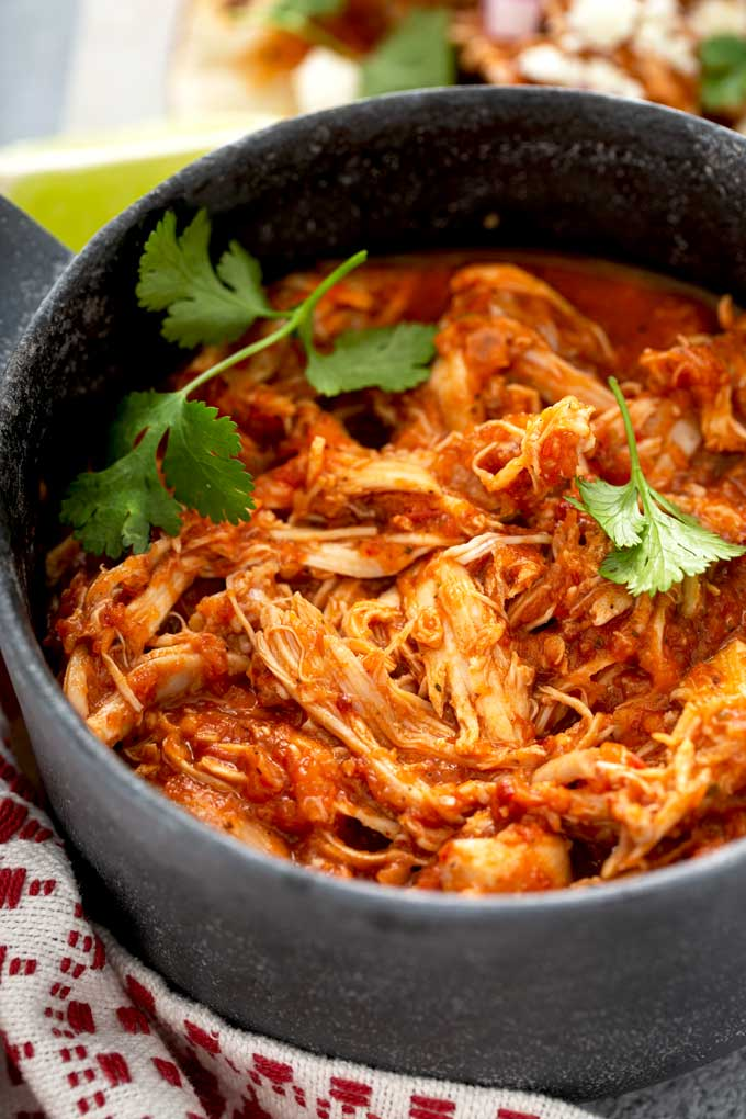 Shredded Chicken Tinga in a black serving bowl