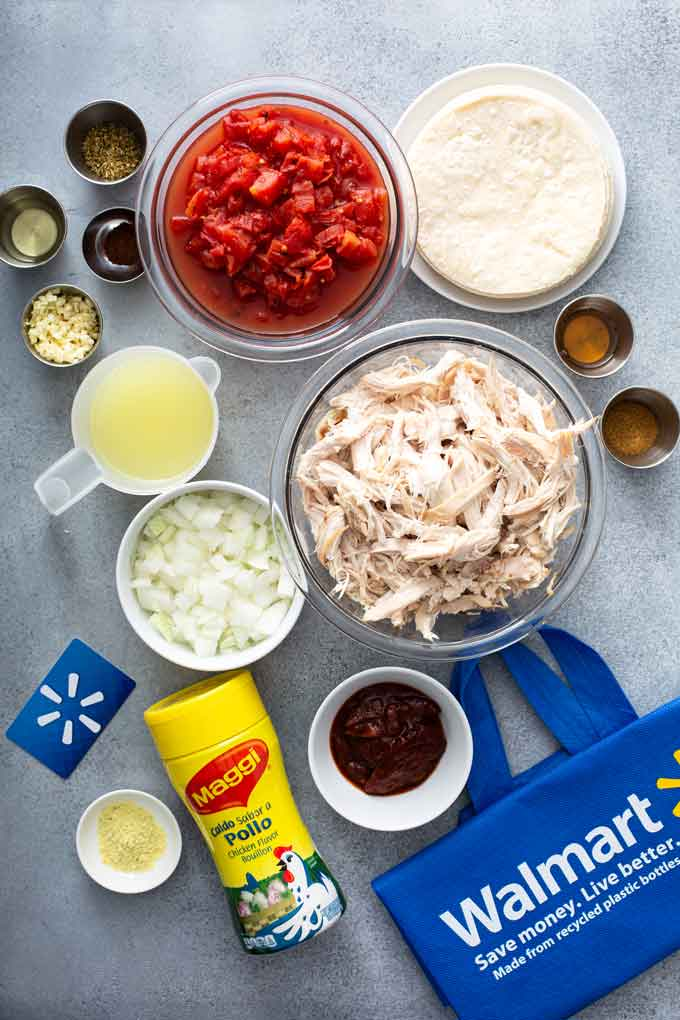 Ingredients to make Mexican shredded chicken tacos.