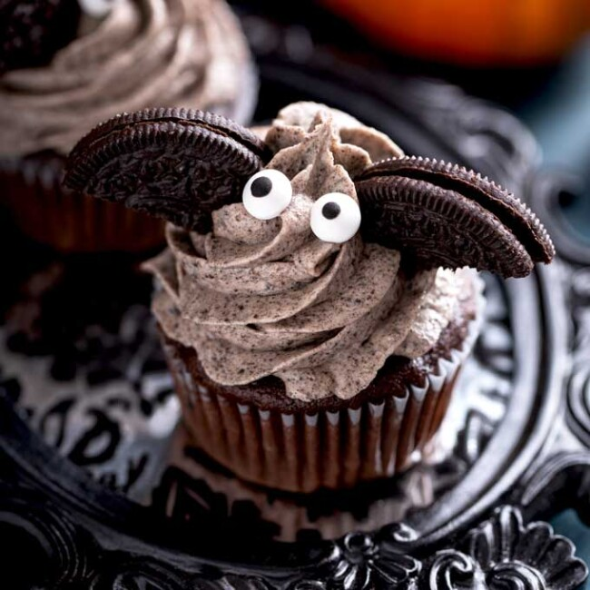 Chocolate Oreo Cupcakes with frosting decorated as Halloween bats