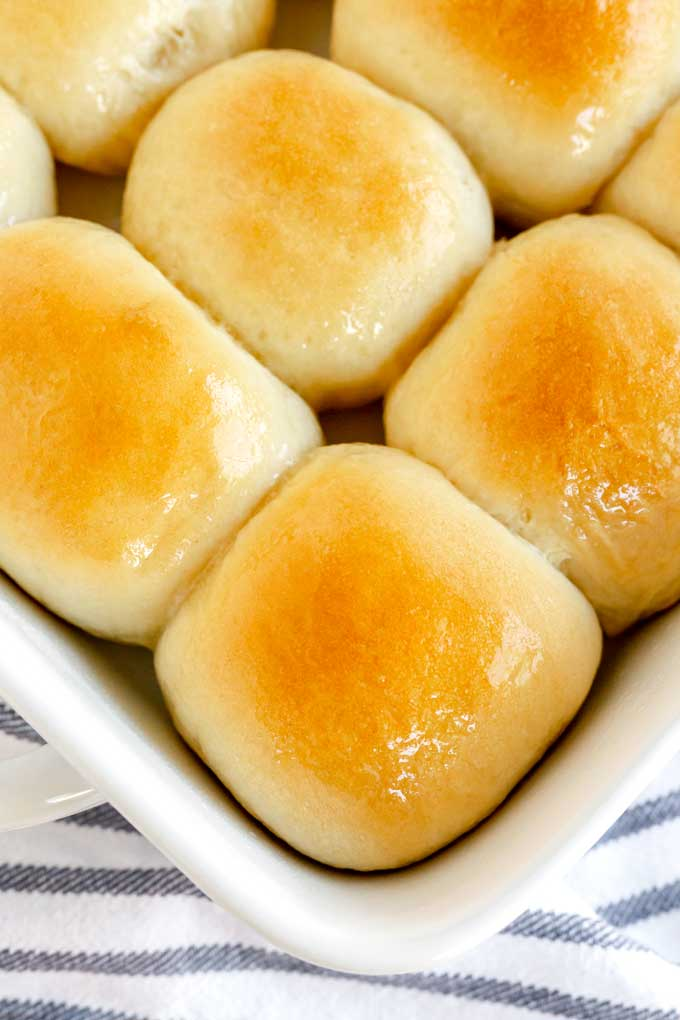 Top view of easy yeast rolls in a baking pan.