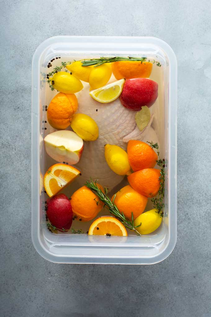 Turkey submerge in a brining mixture with citrus, herbs and spices.