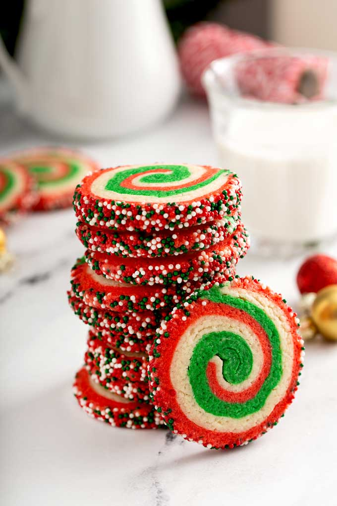 A stack of red and green rolled Christmas pinwheel cookies