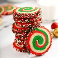 A stack of Christmas cookies on a white surface
