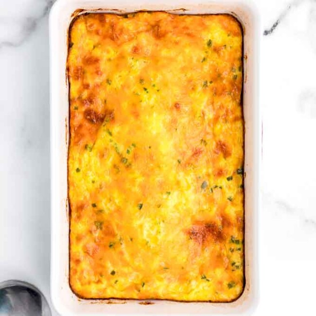 Golden brown corn pudding in baking dish