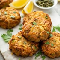 Crispy Golden brown Maryland style crab cakes on a marble surface