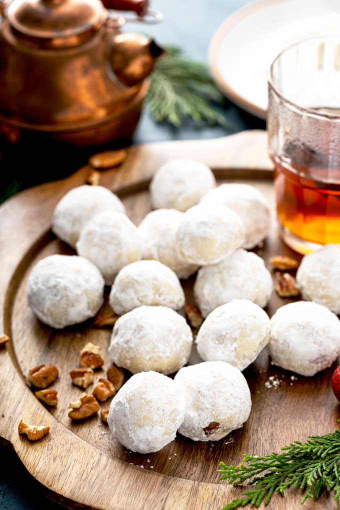 Snowball cookies on a wooden plate