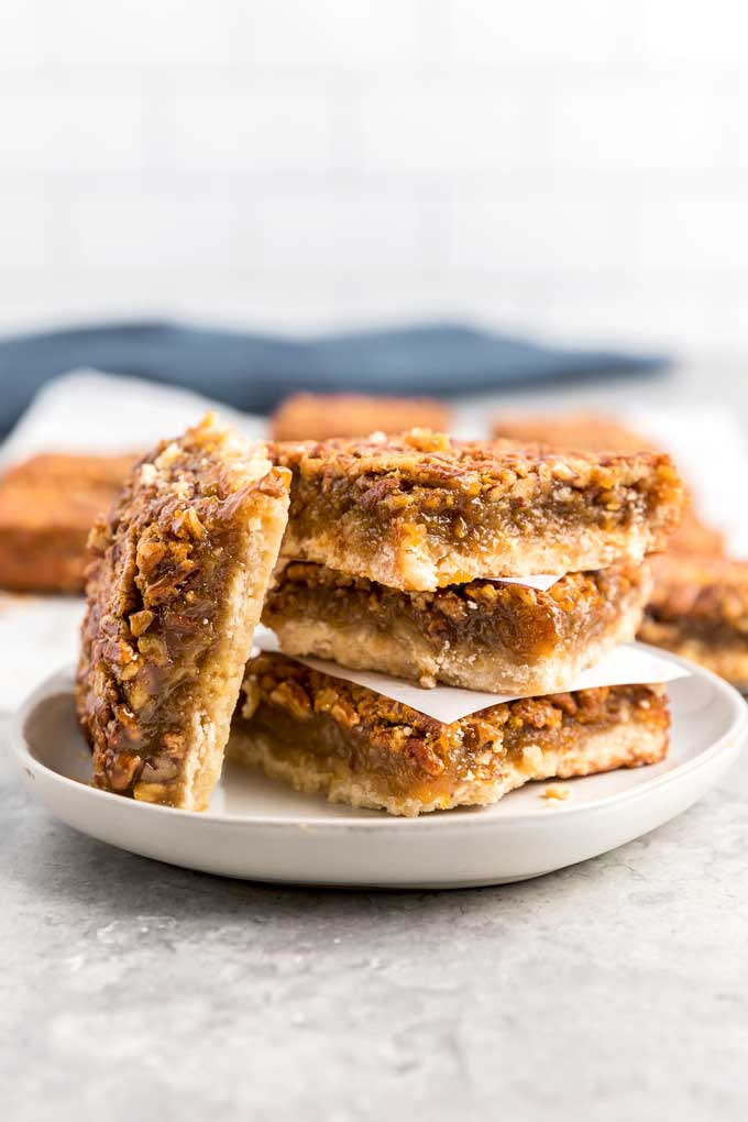 Pecan squares stack on a plate
