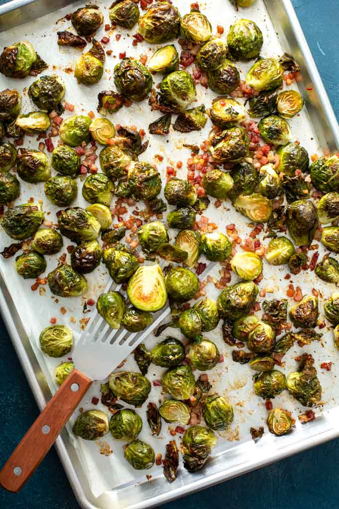 Golden Brussels sprouts and bacon on a sheet pan.