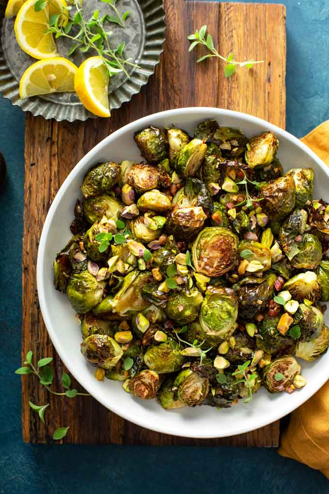 A white bowl filled with Balsamic Brussels sprouts with bacon.