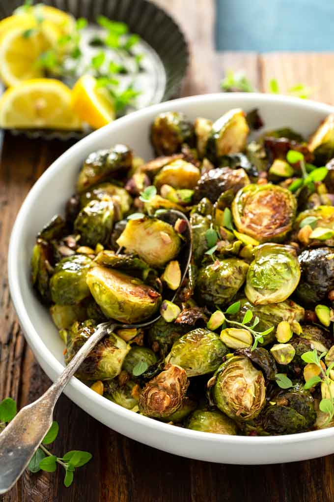 Oven Roasted sprouts in a white bowl.
