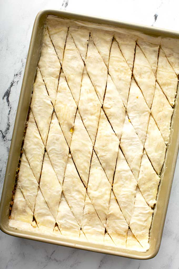 Unbaked Greek baklava in a baking pan