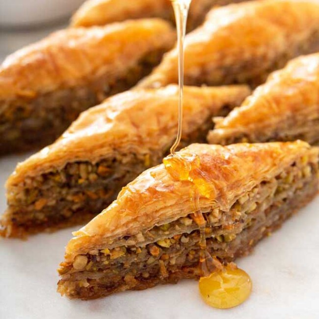 Baklava getting drizzled with honey