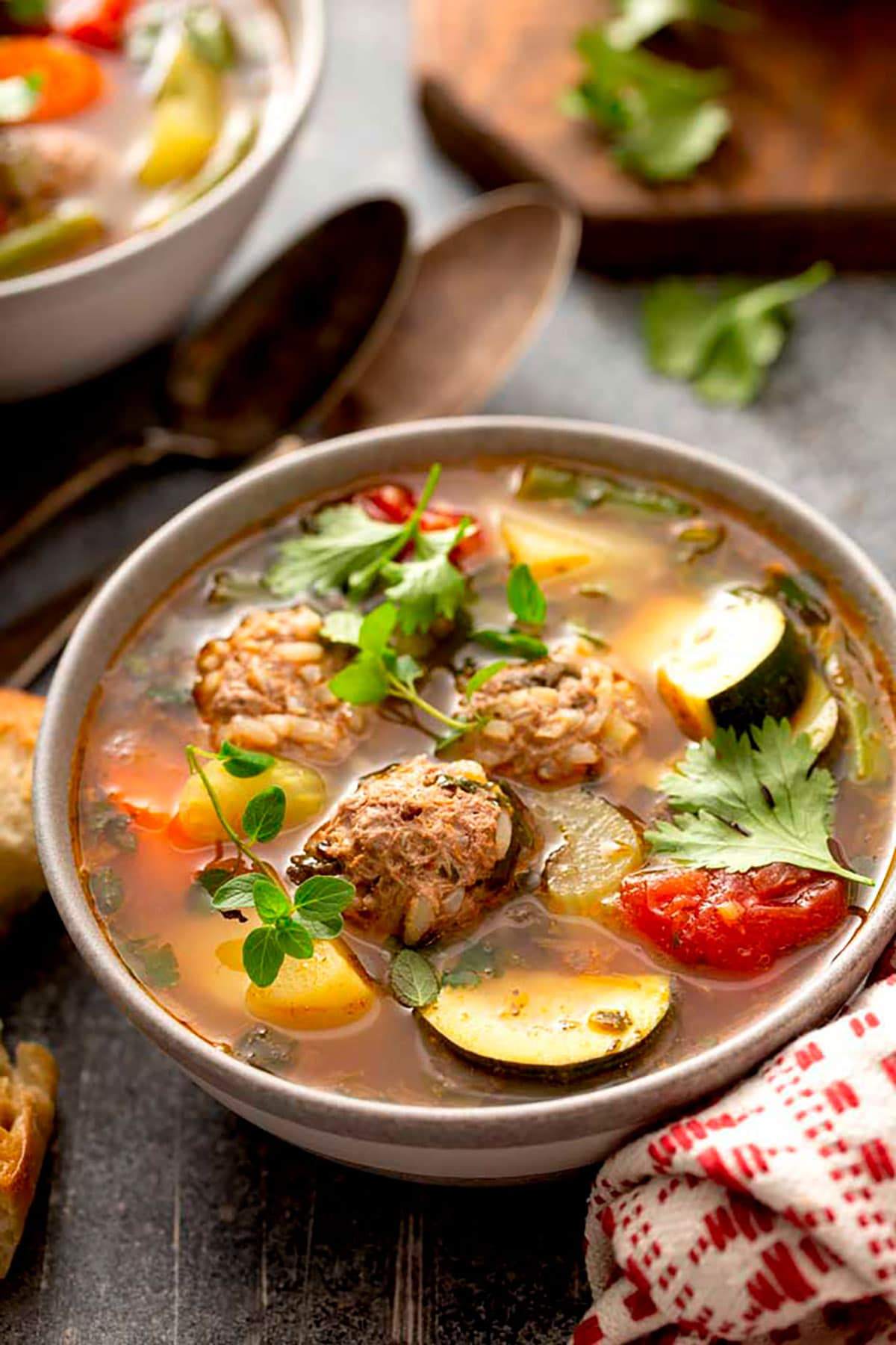 a bowl of Mexican soup with meatballs