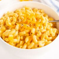 white bowl with cheesy instant pot mac and cheese.