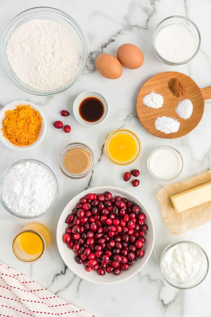 Ingredients to make orange cranberry muffins