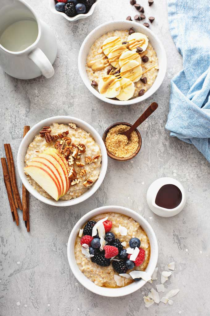 bowls of oatmeal with assorted toppings