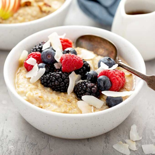 Bowl of steel cut oats breakfast cereal topped with berries