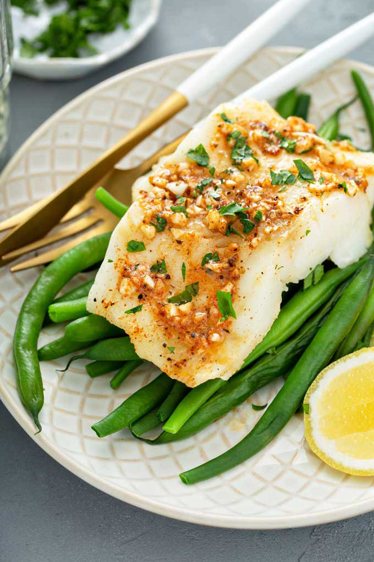 Cod Fish fillet on a bed of green beans