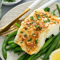 filet of cod baked with Cajun butter over green beans