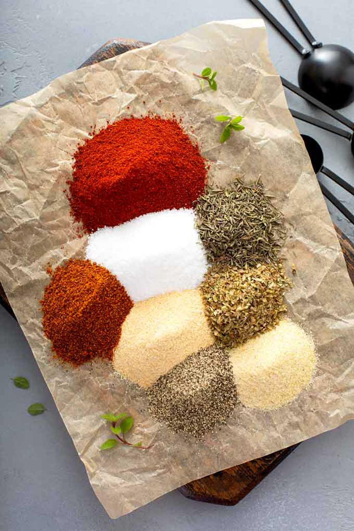 Spices to make this Cajun seasoning mix on a kraft paper.