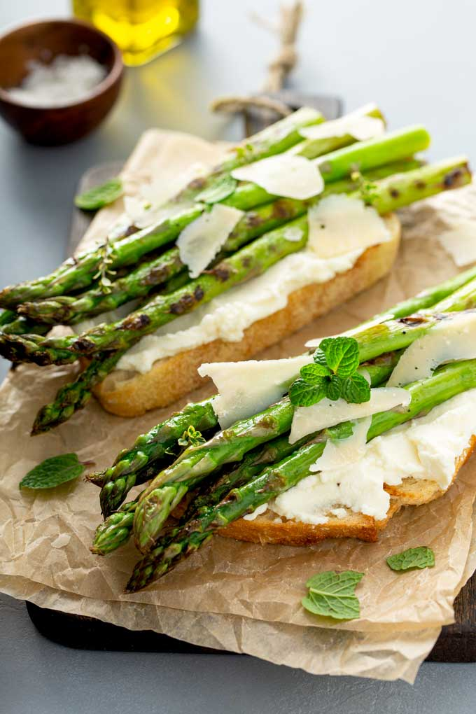 Grilled asparagus on top of ricotta crostini with Parmesan cheese