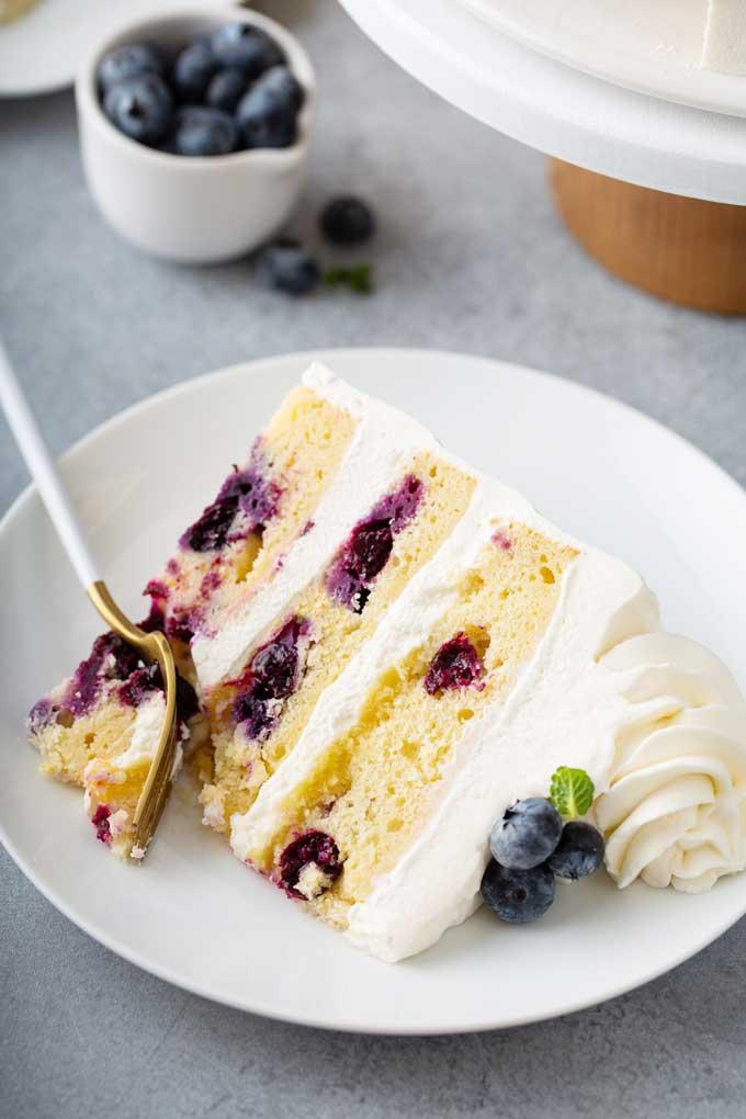 A sliced of Lemon blueberry cake on a plate.