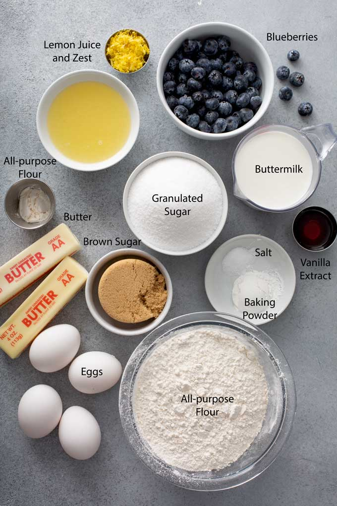 Ingredients to make Blueberry lemon cake on a gray surface