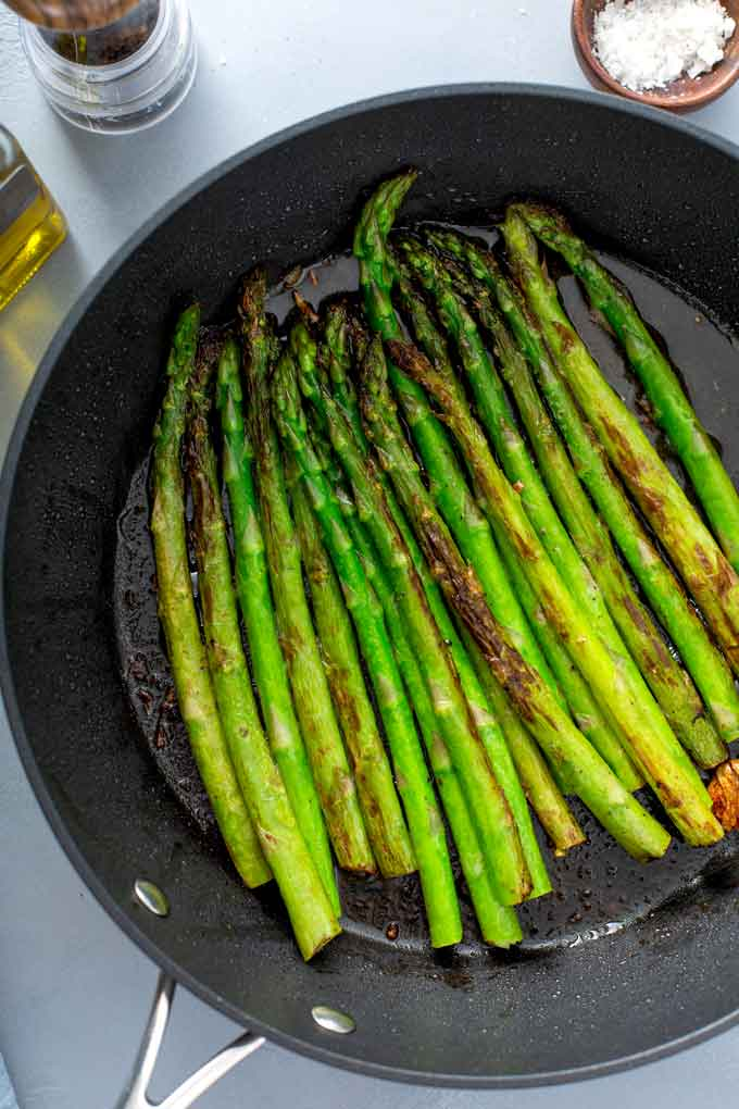 Pan roasted asparagus in a skillet