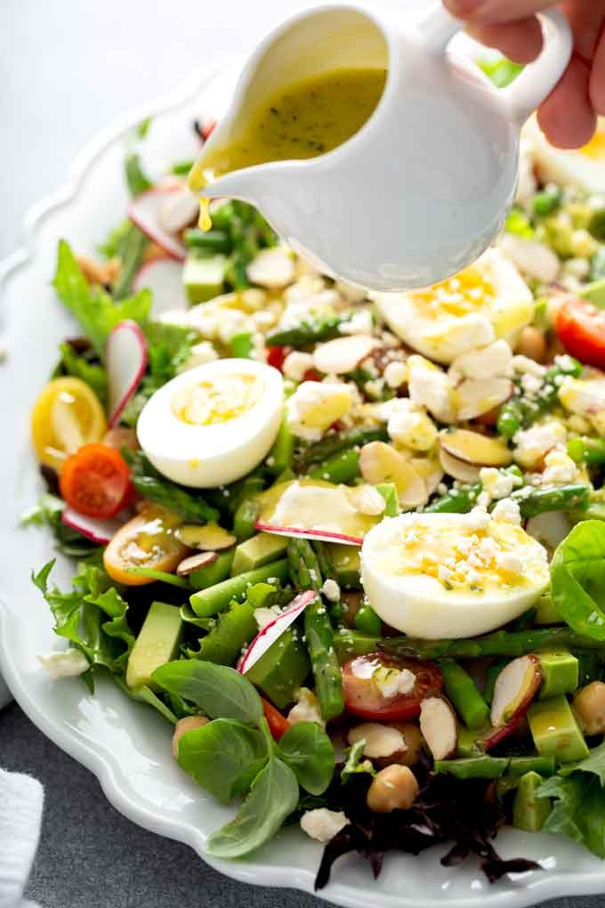 Lemon vinaigrette drizzled over asparagus salad