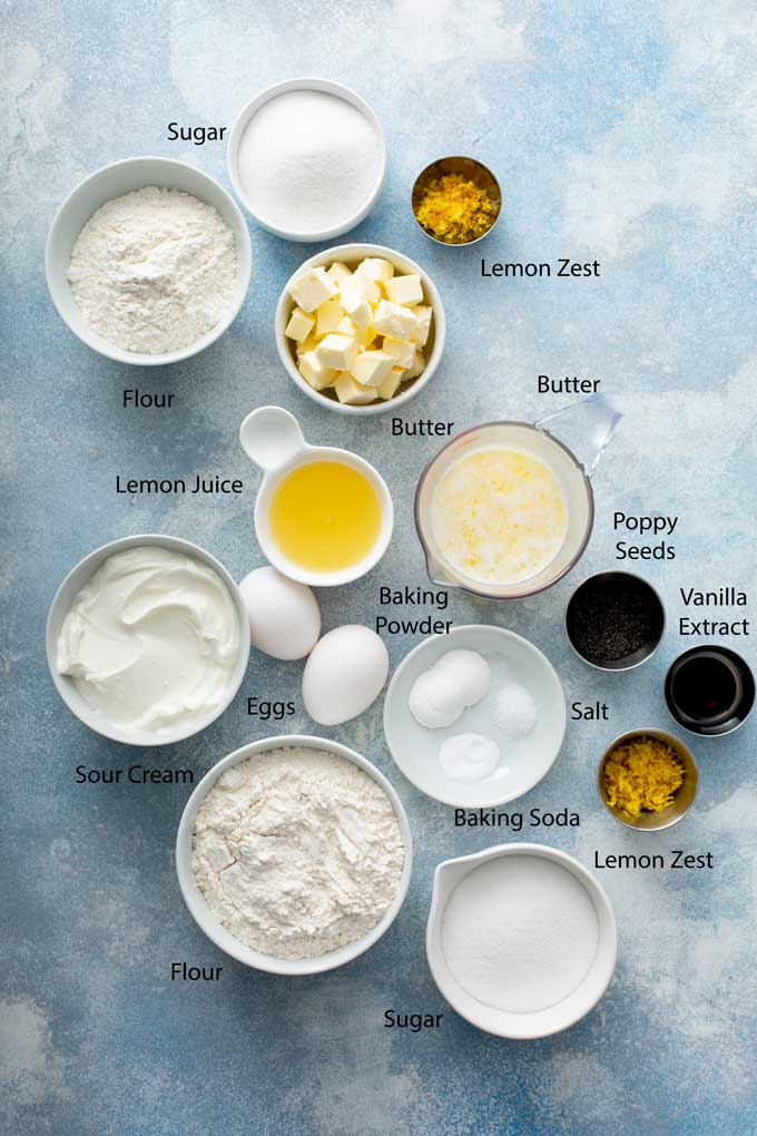 Ingredients to make lemon muffins with poppy seeds and streusel and glaze
