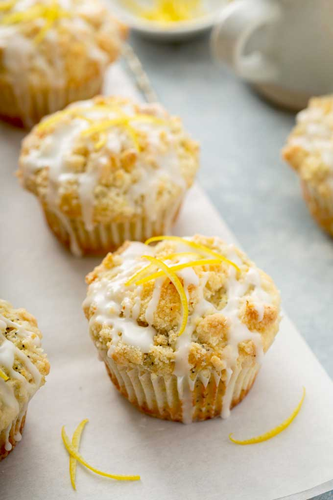 Lemon muffins on a piece of parchment paper.