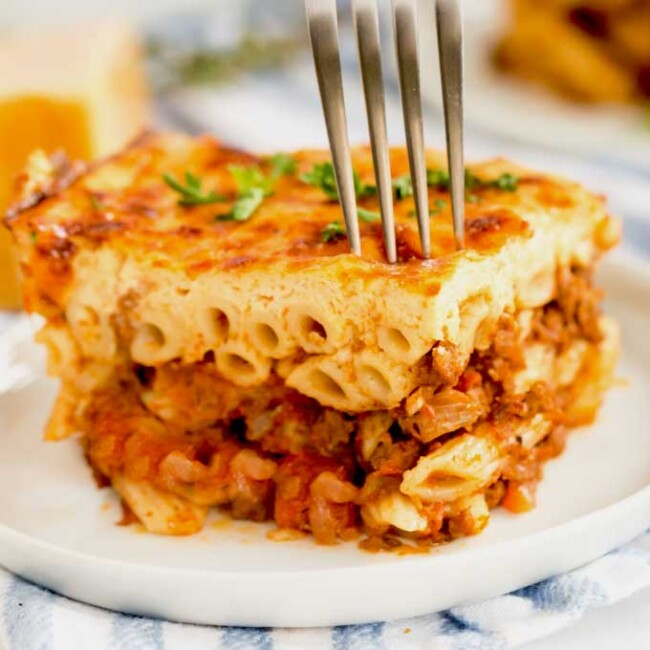 A serving of pastitsio on a white plate
