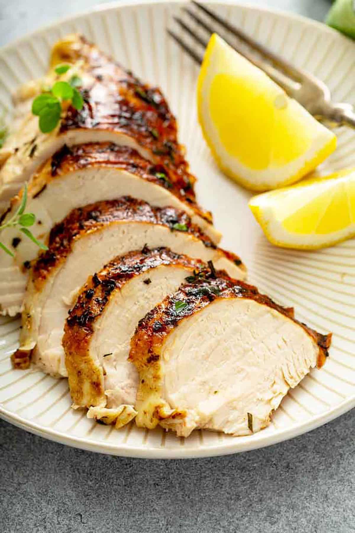 Sliced roast chicken on a plate