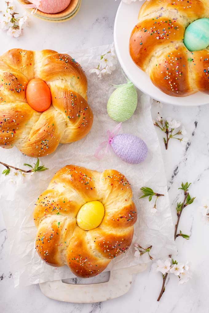 Top view of three wreaths of soft brioche style Easter Italian sweet bread
