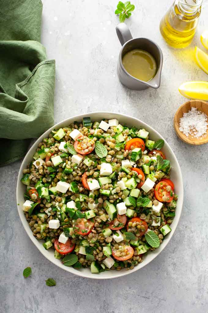 Top view of salad with lentils, herbs and vegetables