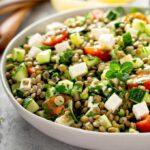 lentil salad in a white bowl