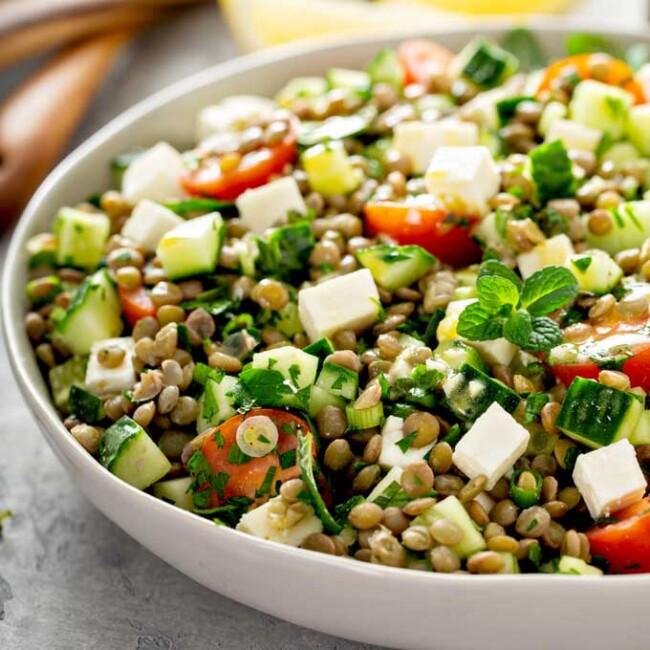 lentil salad in a white bowl