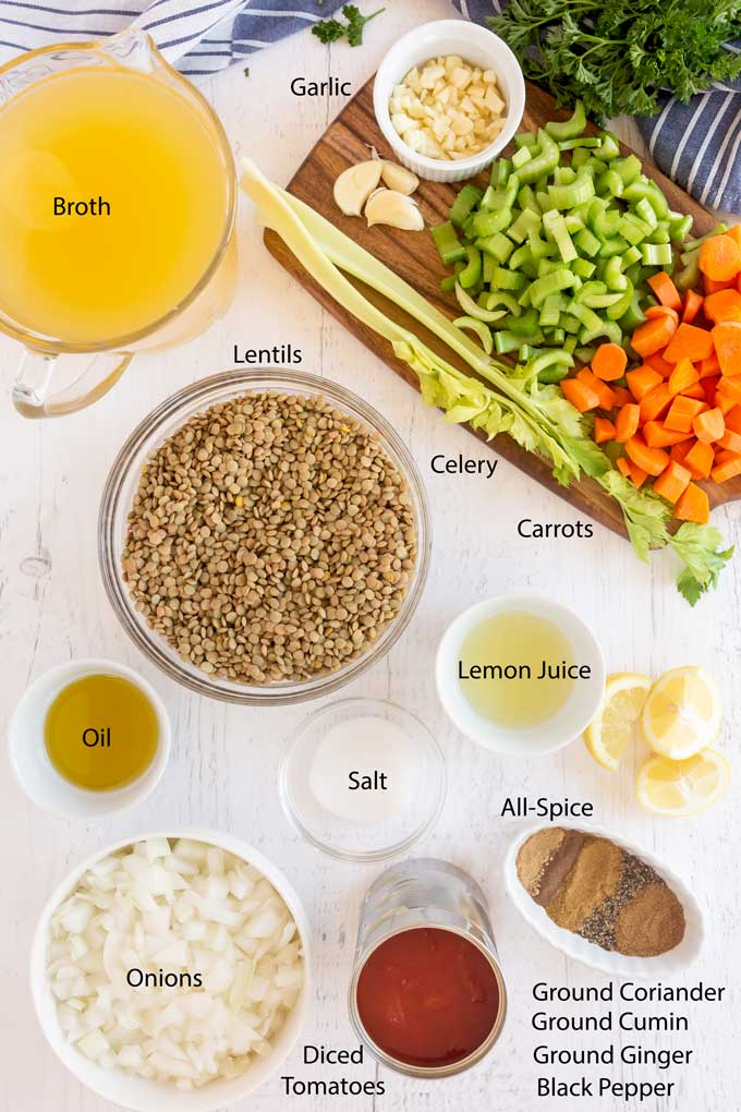 Ingredients to make lentils soup on a white wooden board