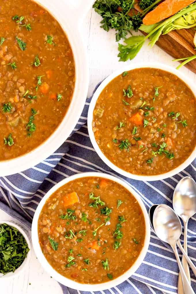 Bowls of lentil soup on a table
