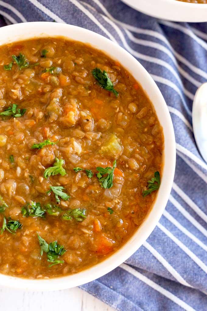 Close up top view of a bowl of lentil soup
