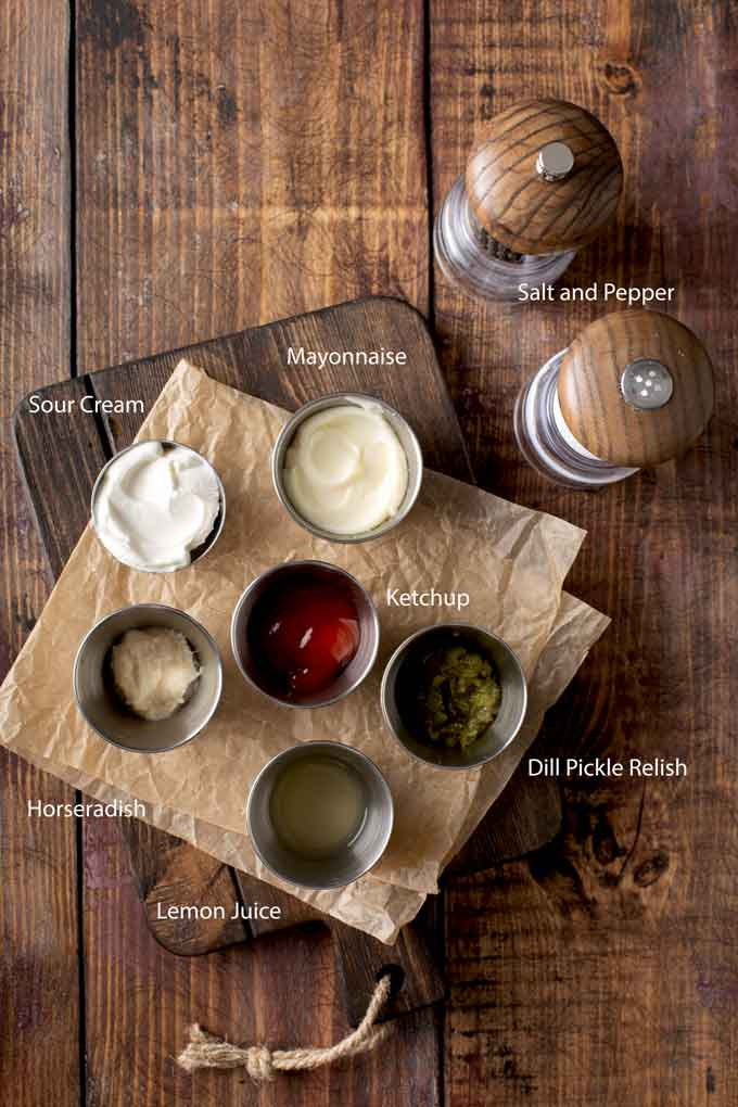 Ingredients to make Russian dressing on a wooden board