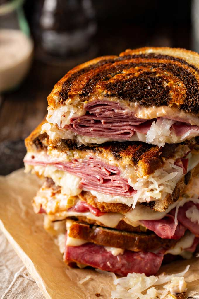 Cut up grilled corned beef sandwich