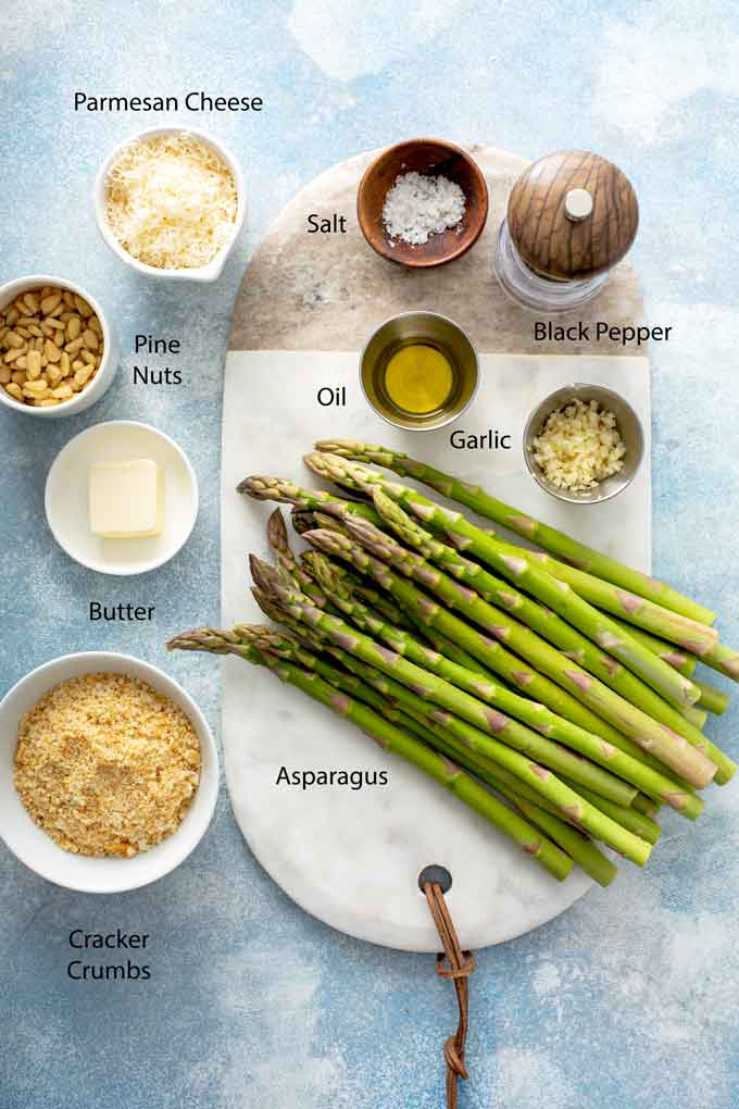 Ingredients to make cheesy and crispy roasted Asparagus