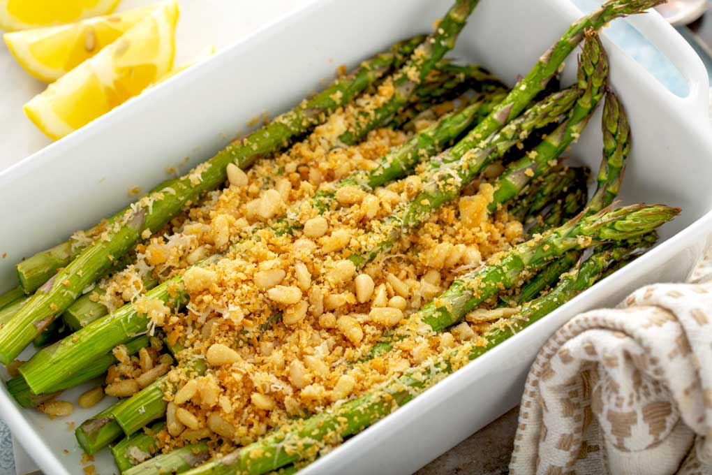 Golden brown baked asparagus with a crispy cheese and cracker crumb topping.