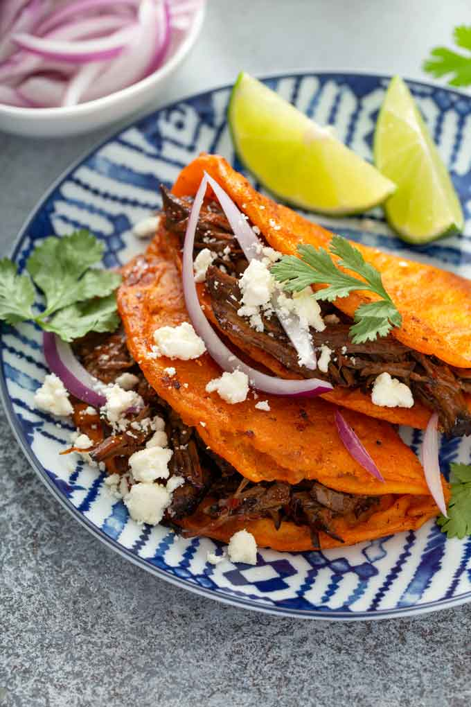 Two Mexican beef tacos on a plate