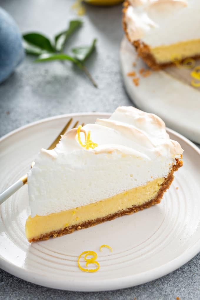A slice of creamy lemon pie made with condensed milk on a plate