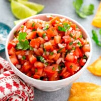 Bowl of pico de gallo with chips and lime