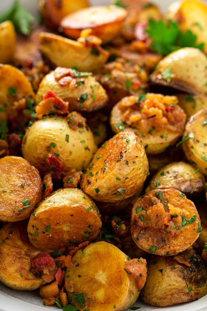 Close up view of skillet potatoes with bacon and herbs