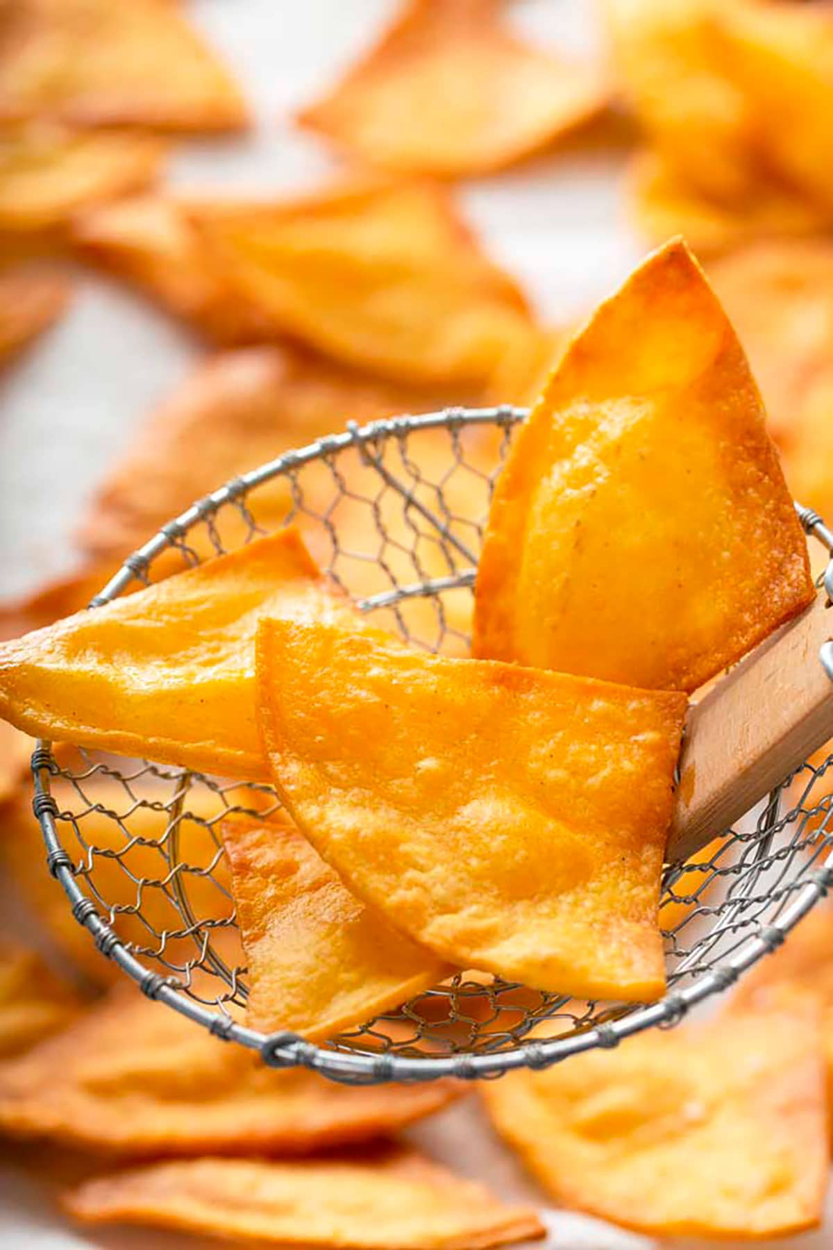 Tortilla chips scooped by a strainer